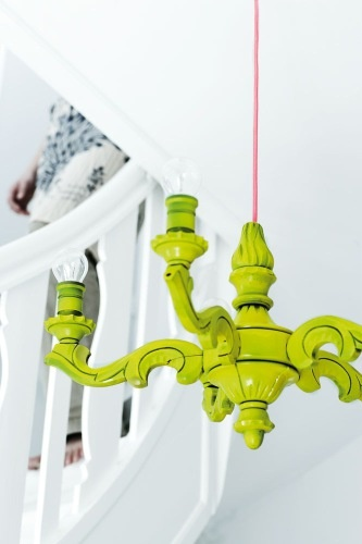 transform a very outdated light fixture with some neon paint.  from very frumpy to very chic.