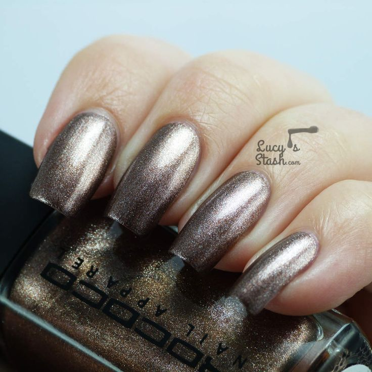 "Rococo Nail Apparel Metal Jacket and Lab Nude 8.8 - Review & Swatches. Metal Jacket is a cool-toned brown metallic with silver metallic particles. Rococo describes this finish as ""molten lava""."