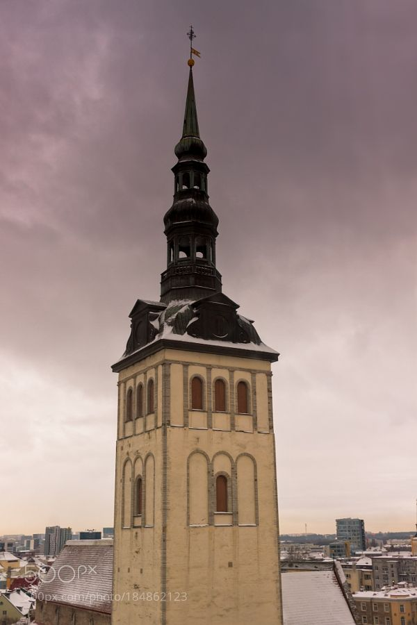 http://500px.com/photo/184862123 Tower Of The St Nicholas Church by JukkaHeinovirta -The tower of the St. Nicholas' Church in Tallinn Estonia seen from the Finnish embassy. St. Nicholas' Church is a medieval former church in Tallinn Estonia. Originally built in the 13th century it was partially destroyed in Soviet Bombing of Tallinn in World War II. It has since been restored and today houses a branch of the Art Museum of Estonia focusing mainly on ecclesiastical art from the Middle Ages…