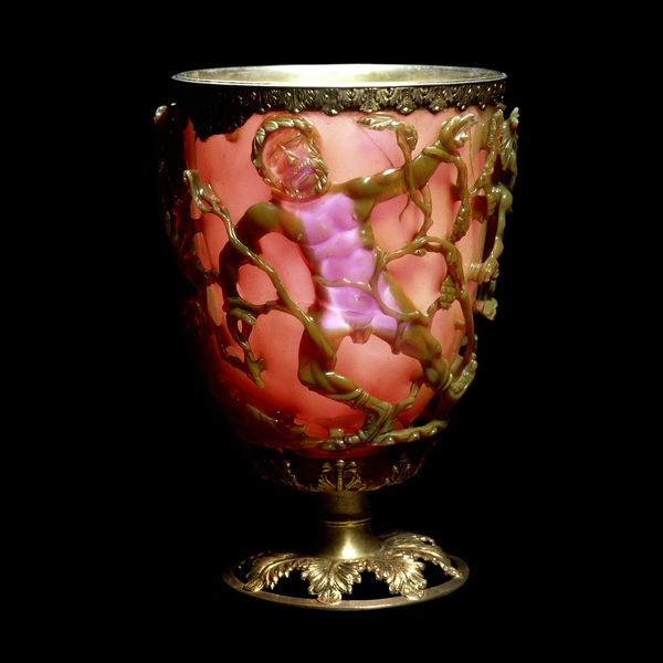 The Lycurgus Cup: This extraordinary cup is the only complete example of a very special type of glass, known as dichroic, which changes colour when held up to the light. The opaque green cup turns to a glowing translucent red when light is shone through it. The glass contains tiny amounts of colloidal gold and silver, which give it these unusual optical properties. Europe AD 300-1100.  View of glass when held up to the light.