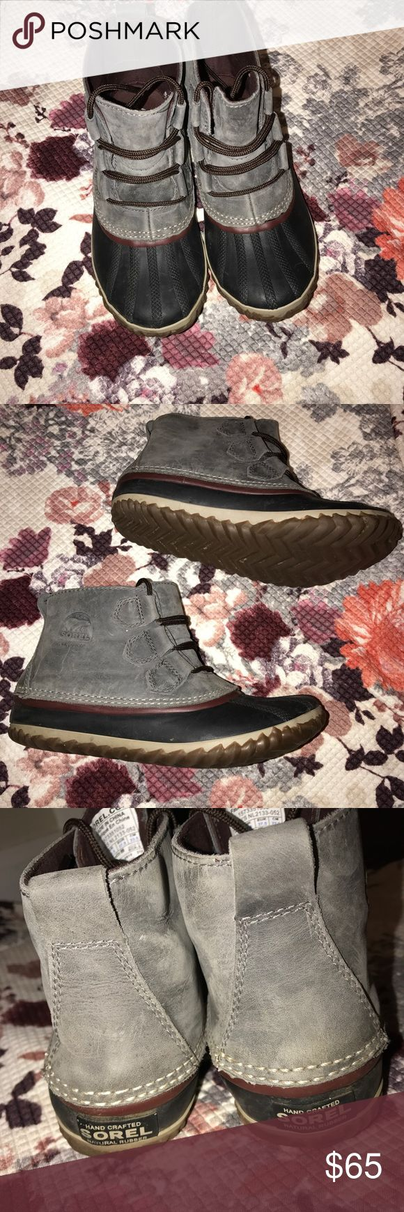 Sorel Out N About Boots Grey duck boots are water proof with a leather upper. Gently used and cared for. No scratches or scuffs. Sorel Shoes Winter & Rain Boots