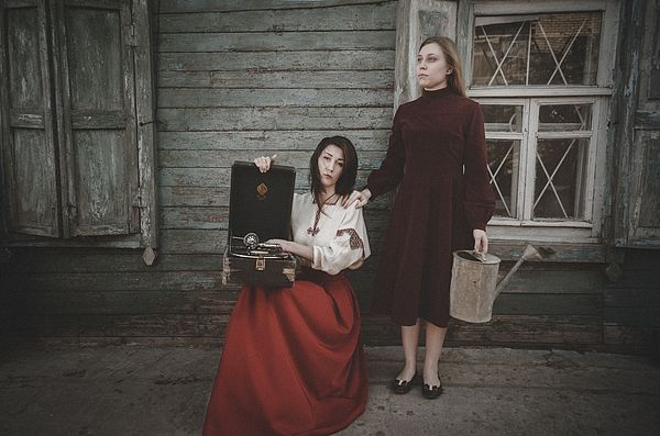 GIRLS WAITING. BACK TO THE PAST by INNA MOSINA.   Belongs to the Gallery RUSSIAN ARTISTS NEW WAVE.   Back to the past SERIES.  The series was conceived as a vintage photography in retro style. This is due to the props, clothes of the main characters, as well as the color and photo processing. With these pictures I wanted to bring the viewer into the spirit of the past, about 30-40 years ago.  #RussianArtistsNewWave #InnaMosina  #FineArtPhotography #Russia #Woman #Past #Canvas