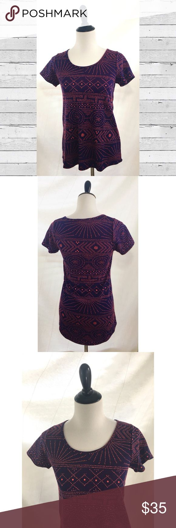 "LuLaRoe Size XXS classic tee purple orange dots LuLaRoe classic tee t-shirt tunic top. Size XXS, oversized fit. Excellent condition with no apparent wear.  High low fit and flare type of style with short sleeves. See measurements, which are approximate and flat lay: Bust: 16"" Waist: 16.75 Across bottom: 21.25"" Front Length at shoulder: 25.5"" Back length in the middle: 27.5"" Color is like a dark ultraviolet purple with what looks like Orange colored dots (maybe salmon?) in a geometric…"