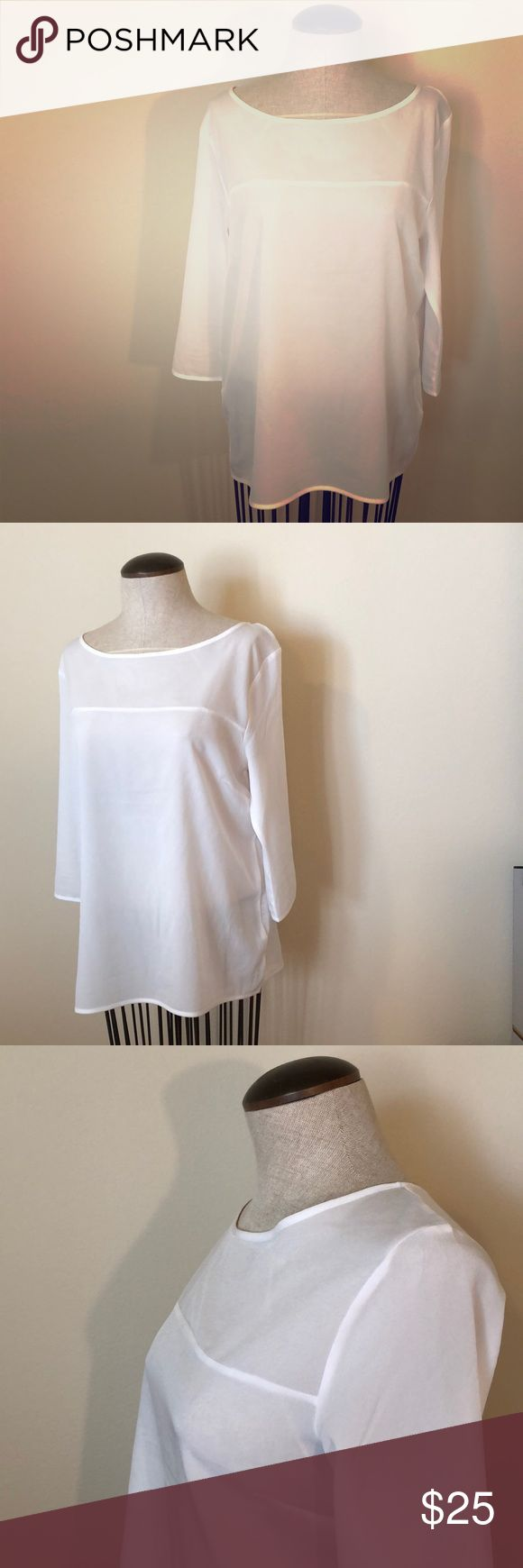French Connection White Pull-Over Blouse French Connection White Pull-Over Blouse Size L, Delicate little details in this simple pull-over Blouse. Worn once - with a cami underneath, high waisted quilted skirt & black flats:)  Great for work & casual outfit combinations. French Connection Tops Blouses