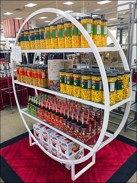 No other similar shelf unitswere seen in-store, which leads me to believe this Hoop-shaped Shelf Unit was the idea of the Gourmet Popcorn Brand. And if you are going to sell popcorn in a departme...
