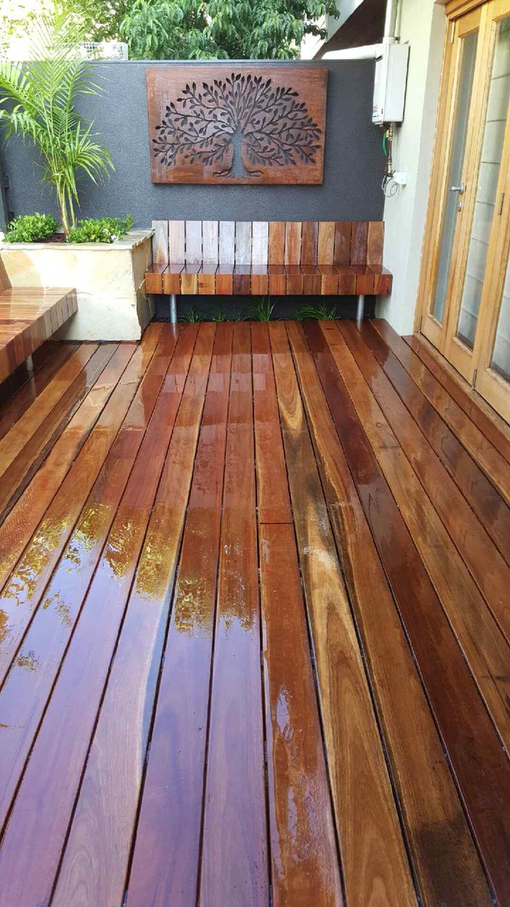 Spotted gum decking, built in seating  with sandstone planters sets the scene in this little courtyard garden. www.rpgardendesign.com.au