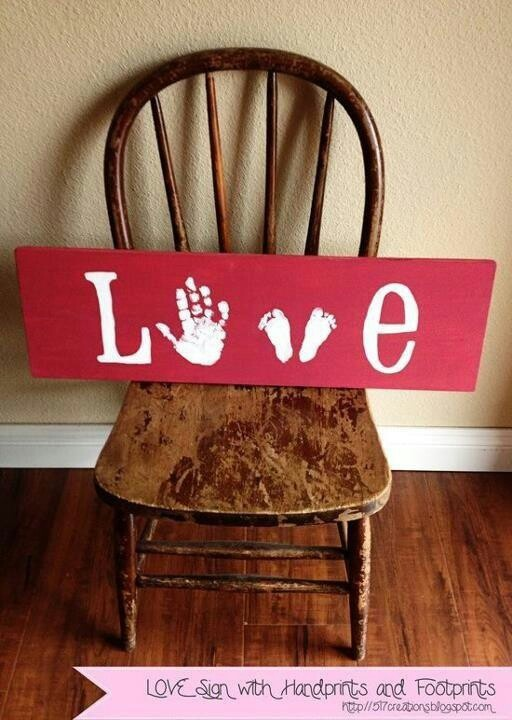 Love with hand and foot prints.....might be cool if you could do the L & E a collage of pictures