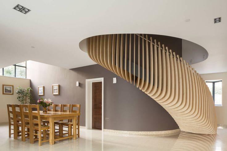 Pasillos, vestíbulos y escaleras modernos de Frost Architects Ltd