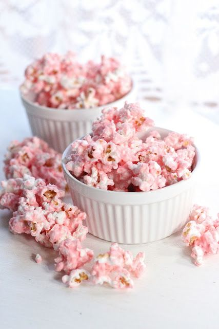 Pink White Chocolate Popcorn would look adorable at a little girl's baby shower. #pink #babyontheway #babyshower #babygirl
