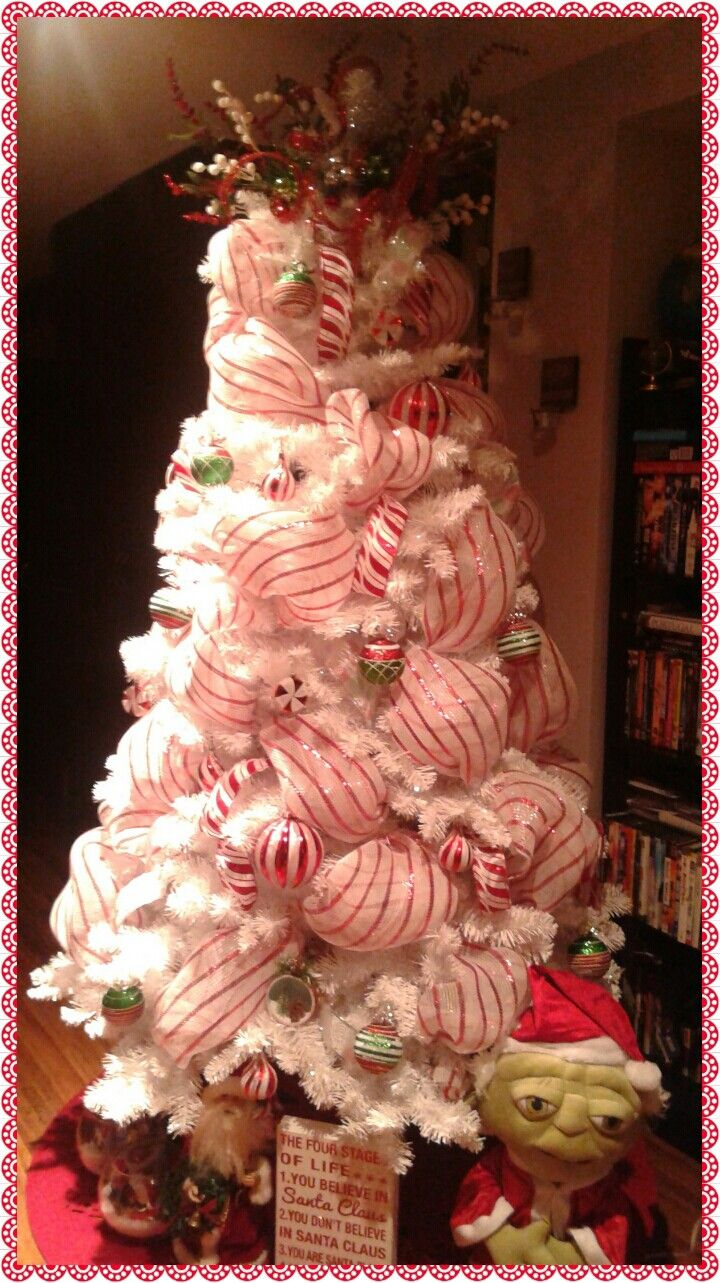 Peppermint Christmas tree... Tree topper all dollarama store items that I put together.  makes your tree pop with festive cheer....
