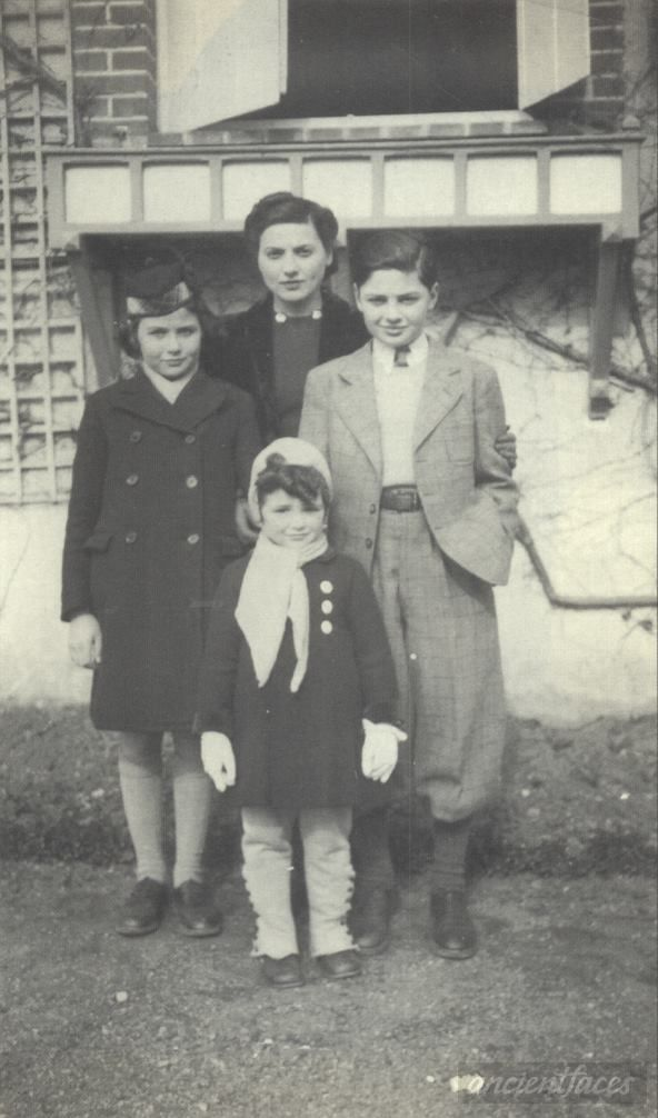 Photo taken in Paris, France possibly in 1941/1942-few months before deportion of Jean Pierre Lambert standing in front of his mother and two older siblings. Jean-Pierre was sadly murdered in the gas chamber on November 22, 1943 at age 7.