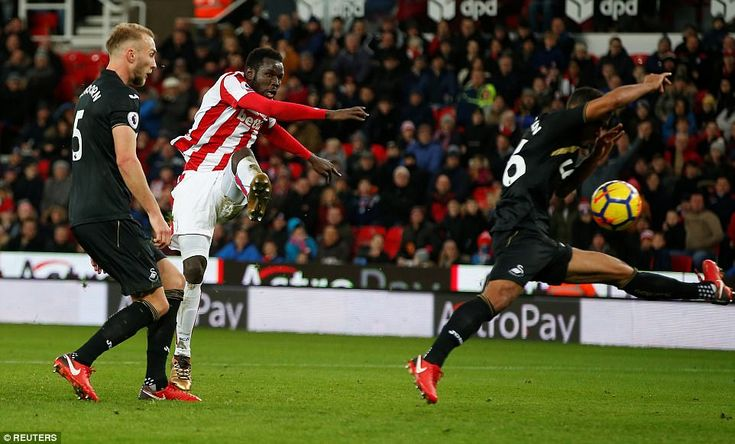 Diouf latches on to a knock-down from Peter Crouch before firing his left-footed strike pa...