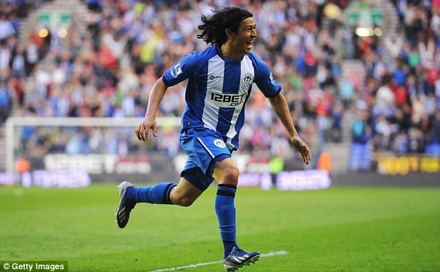 ~ Roger Espinoza of Wigan Athletic celebrating his goal against Swansea City AFC ~