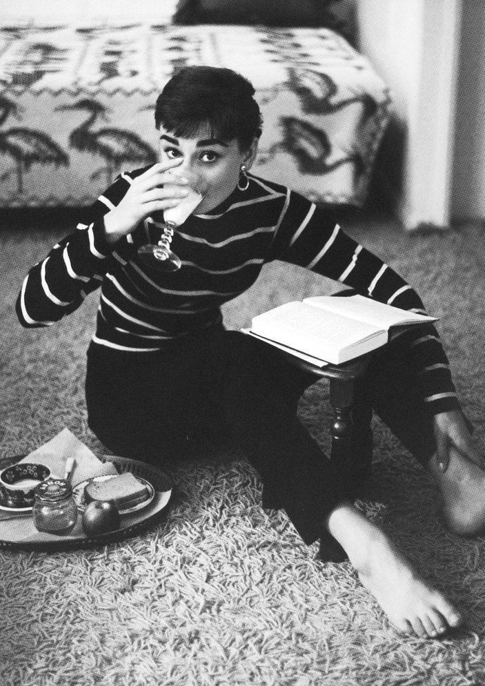 Audrey Hepburn reading.
