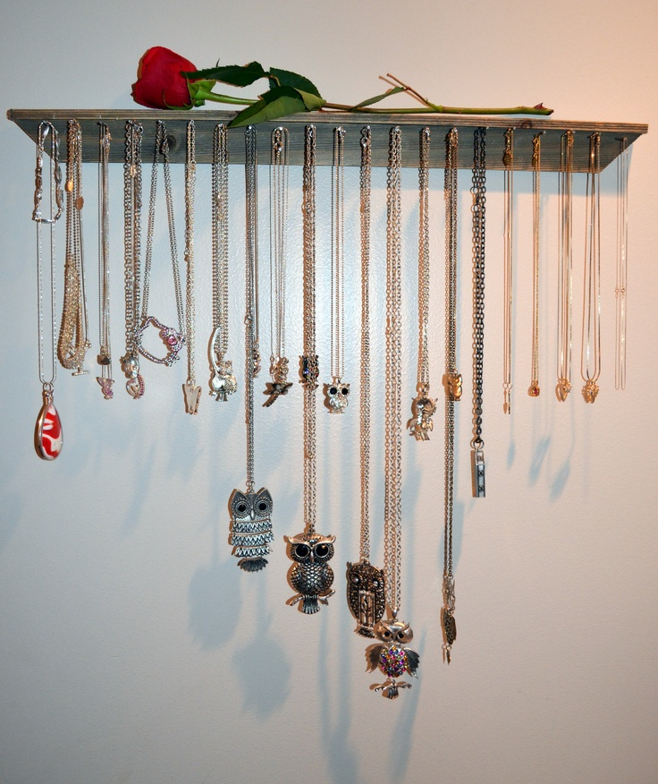 I needed something to hang my necklaces on so I made this out of a broken picture frame and nails