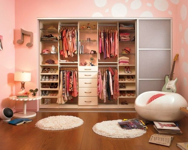 Eclectic Closet with Ikea Komplement Glass Shelf, White, Shag rug, Hardwood floors, Built-in bookshelf, Custom closet storage
