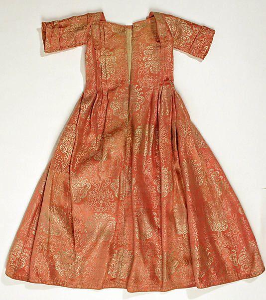 Child's dress, Europe, first quarter 18th century. Orange silk brocade.