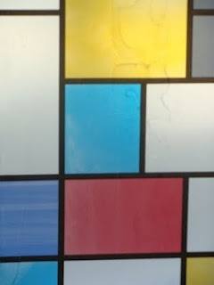 Noel Clueit, Untitled (Mondrian fablon applied to windows) (2009)