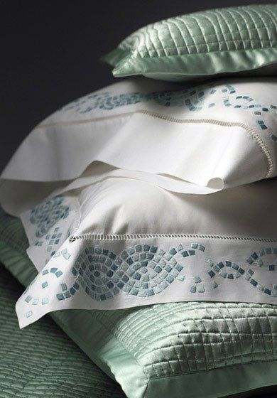 Mosaic:  Inspired by ancient Grecian ornamentation, our hand-embroidered mosaics breathe freshness and life into this bed set, evoking the craft culture of a classical period. In your choice of aqua, coral or sage.