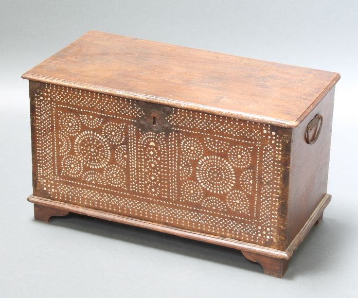 """Lot 911, An 18th Century Moorish style oak coffer the interior fitted a candle box , the front profusely inlaid mother of pearl with iron lock and iron drop handles to the sides, on bracket feet, 16""""h x 28w"""" x 15""""d est £200-300"""