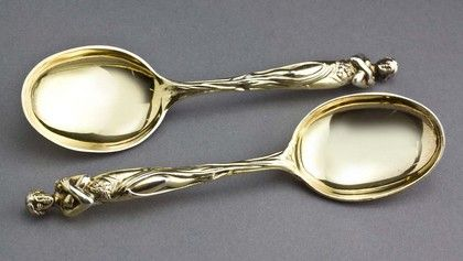 Victorian Silver Gilt Goddess Spoons (Pair) A magnificent pair of Victorian silver gilt spoons, with a beautiful figure of a maiden (or Goddess), sculpted with lovely detail. She is full figure, with a long flowing dress with a high slit, with flowers adorning the front. She holds her arms crossed, and has her hair in a bun. The design has a strong Art Nouveau look and feel, these spoons were well ahead of their time when made in 1873. The spoons are very good quality and... antique silver