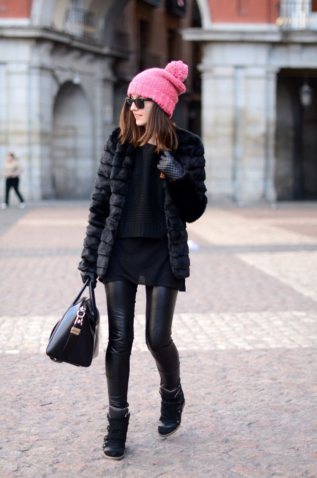 The pop of pink adds a nice color dimension to an all black outfit