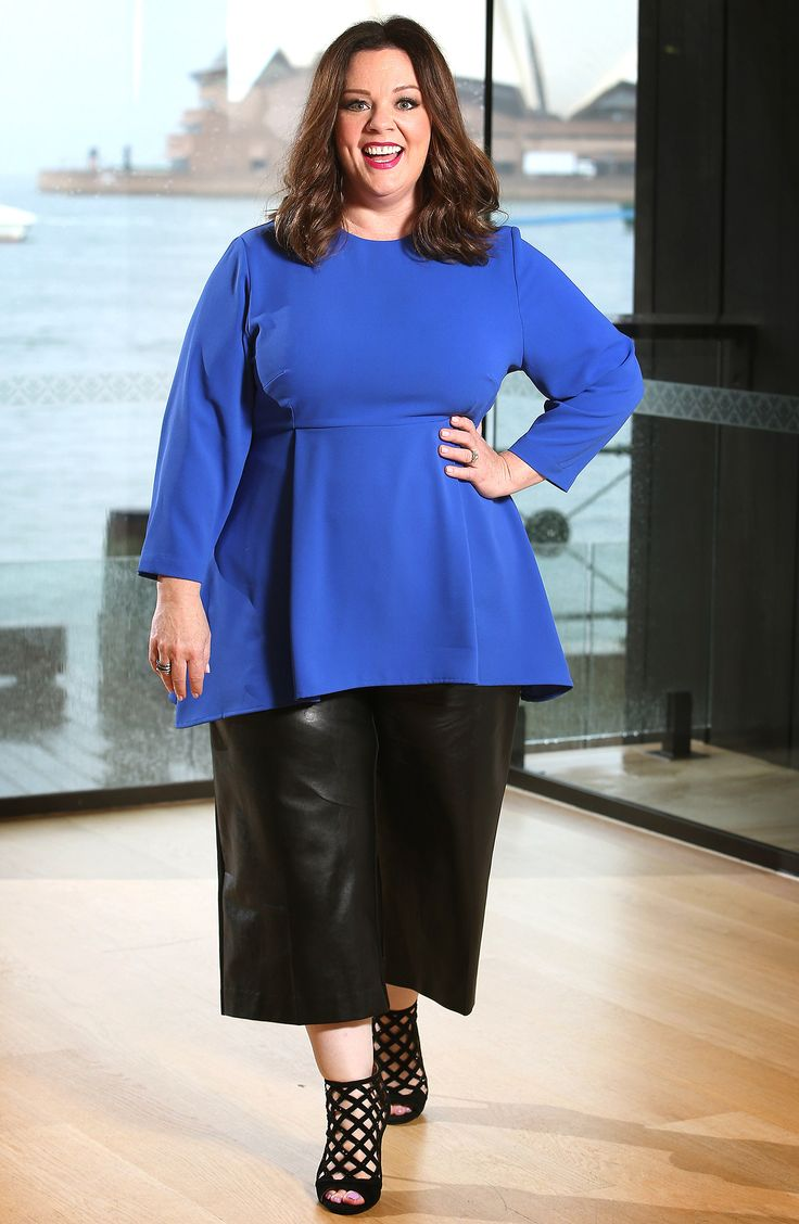 MELISSA MCCARTHY in a royal blue peplum top with leather culottes and caged booties at a photo op at a screening of The Boss in Sydney, Australia.