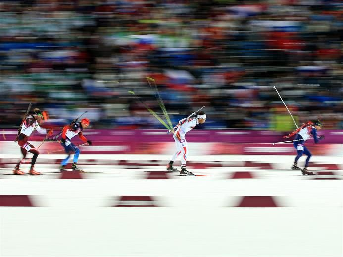 Sochi 2014 Day 4 - Biathlon Men's 12.5 km Pursuit (R-L) Ole Einar Bjoerndalen of Norway, Martin Fourcade of France, Anton Shipulin of Russia, Dominik Landertinger of Austria and Jean-Philippe le Guellec of Canada compete in the Men's 12.5 km Pursuit