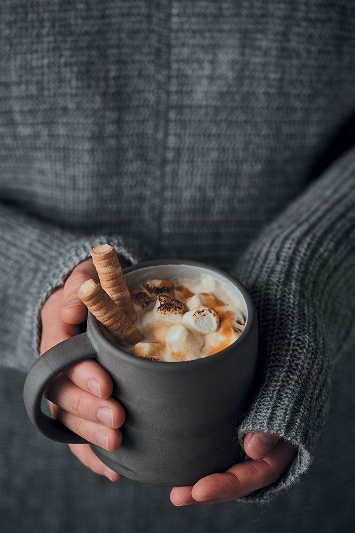Home-made white hot chocolate with caramel and toasted marshmallows