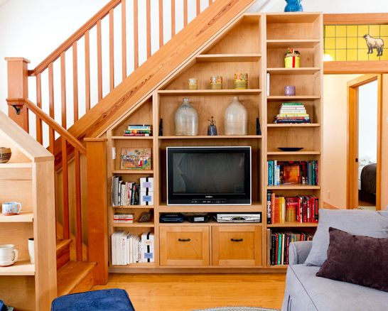 Keep your TV in a special spot. | 27 Genius Ways To Use The Space Under Your Stairs