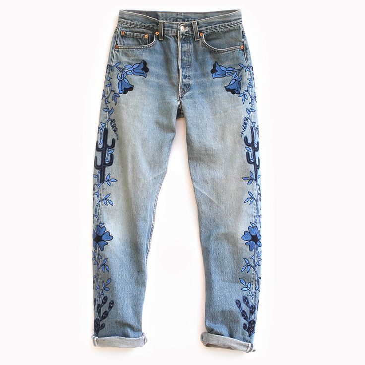 Combining elements of vintage Hollywood western wear with a modern color  palette and design, The Face of the Desert Denim features chain stitch  embroidery in shades of blue and navy on an authentic pair of vintage Levis  501s.  This item is Made to Orderin approx. 4 weeks from purchase date.  CONTENT + CARE - Cotton - Dry Clean - Made in the USA  SIZE + FIT -Medium to high-rise - Relaxed, slightly tapered leg - For a lower rise fit that is loose through the hip and bum, order 1-2  sizes…