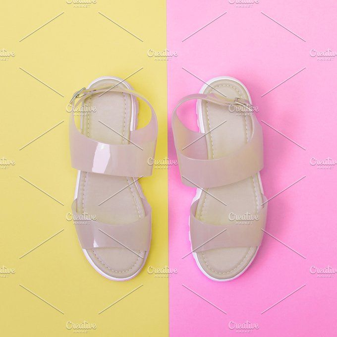 light rose sandals Photos light rose plastic transparent sandals on pink and yellow backgrounds by Katya Havok