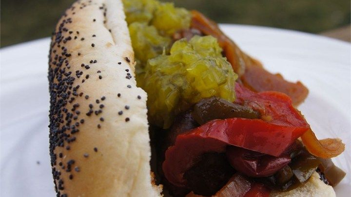 This recipe is very easy and makes delicious bratwurst.  My guests always ask for these during football season.  You won't be able to get enough onions and peppers in the slow cooker because every time we make them, we run out!  This recipe is for 10.  If you have a very large slow cooker, you can get 15 in, but most can only hold 10 (you may need another slow cooker if making more).