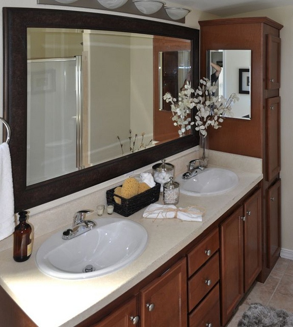 beautiful bath in a home love these cabinets