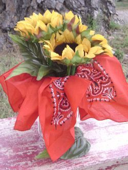 fun country centerpieces | Bandanas and sunflowers combine for a striking centerpiece in this ...