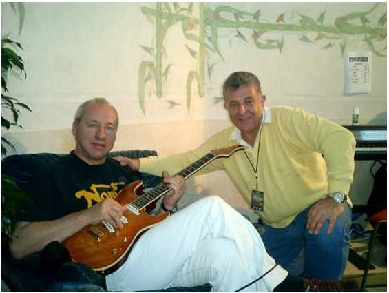 Mark Knopfler and Rudy Pensa in 2005 just before appearing in a tv show when Rudy gave Mark the Pensa MK 2 Plus