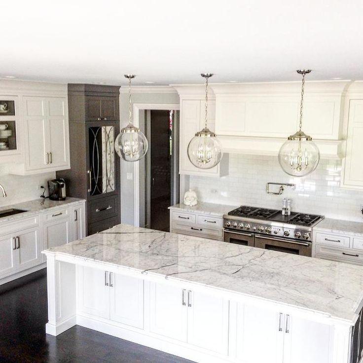 White Kitchen Pinterest: White And Gray Kitchen Features Three Clear Glass Globe