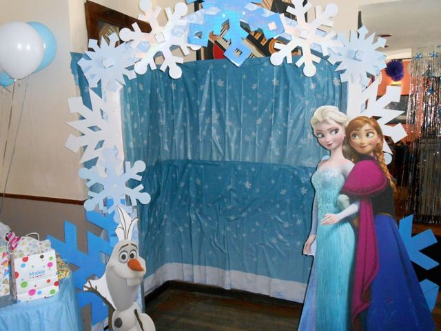 Frozen Birthday Party Decor!  Guests enjoyed photo ops with Elsa, Ana and Olaf cardboard cutouts in our winter wonderland photo area.