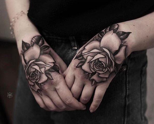 hand rose tattoos