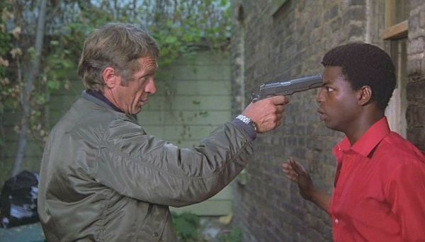 Ralph 'Papa' Thorson (Steve McQueen) holds an M1911A1 to the head of Tommy Price (LeVar Burton) in the 1980 movie, The Hunter.