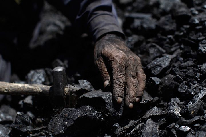 Islamabad, Pakistan: A 69-year-old man breaks coal as part of his daily work in a brick factory