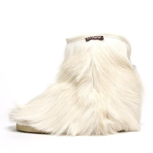 The gorgeous goatskin cowboy ankle boot is perfect for glamorous après-ski relaxation. Constructed in macedonian goatskin with tassle detail. The deep soft sheepskin lining and EVA sole make this style incredibly warm and comfortable. Boot height 20cm. www.mou-online.com