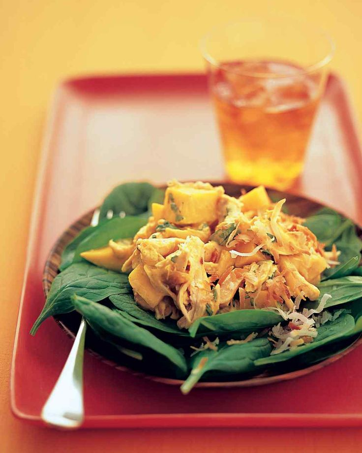 Mango Chicken Salad | Martha Stewart Living - This Indian-inspired chicken salad combines shredded chicken and diced mango in a spicy yogurt dressing seasoned with Major Grey's mango chutney, lime juice, turmeric, cayenne pepper, and fresh cilantro. Serve the chicken salad on a bed of spinach, sprinkled with toasted coconut.