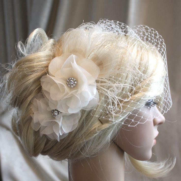 Ivory Silk organza flowers hair clip and birdcage veil ( 2 items) wedding reception bridal party. $120.00, via Etsy.