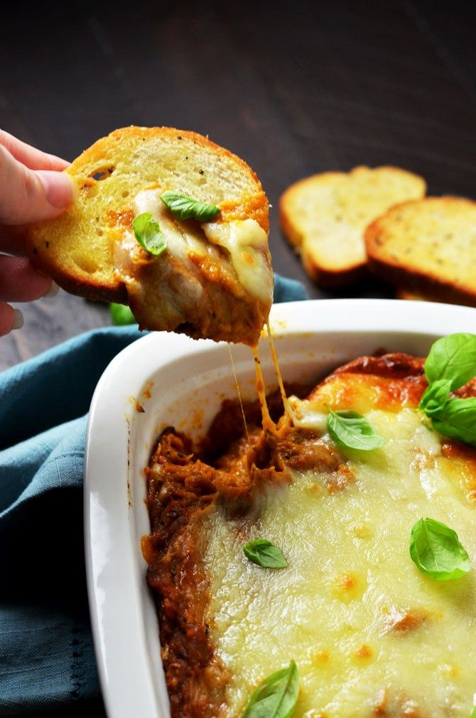 Eggplant Parmesan Dip. This warm, cheesy dip is loaded up with tomato sauce, garlic, and roasted eggplant. I love making it for winter parties.