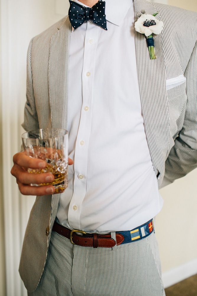 Ashley & Raj's Block Island Wedding • The Melideos - groomsmen attire: polkadot bowtie, seersucker suit, glass of whisky!