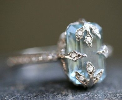 aquamarine. I would be perfectly happy with a unique engagement ring such as this.