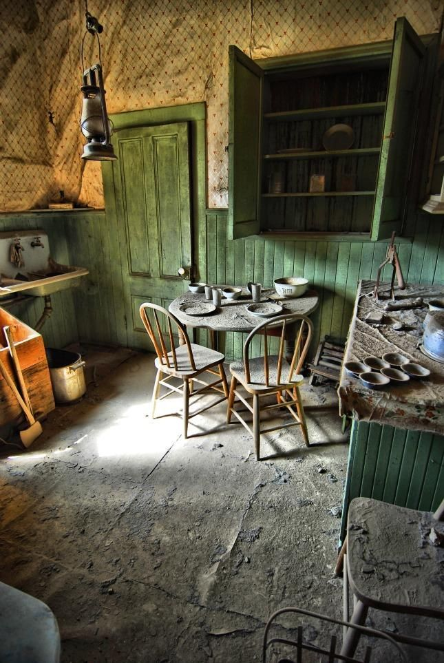 Kitchen in Abandoned Home - A thick layer of dust covers this abandoned kitchen in Bodie, California.