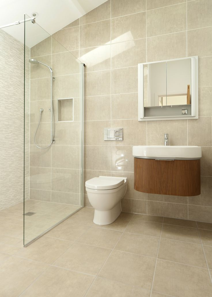 Recessed mirror cabinet and furniture basin create clever storage solutions. Copyright The Designer Knowledge.