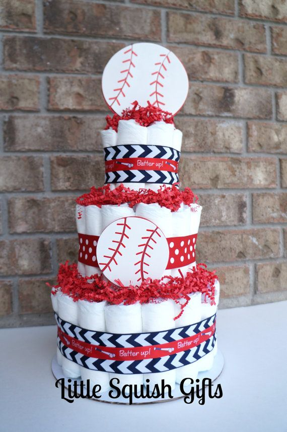 Three tier baseball diaper cake, great for a baby shower centerpiece or baby gift. All diapers are fully functional.  Made with premium ribbons